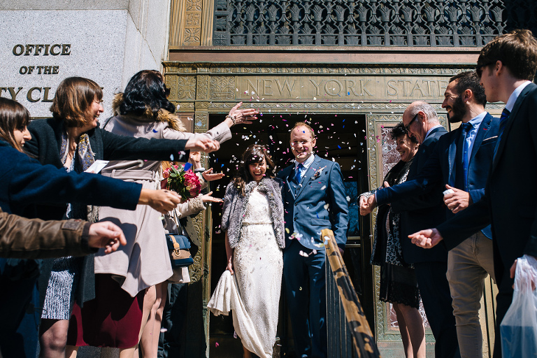 Bride and groom exiting their NYC City Hall elopement