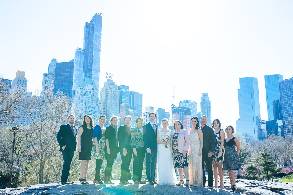 Central Park group photo of wedding party with NYC skyline