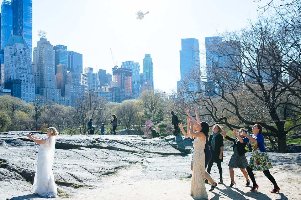 Bride tosses the bouquet in Central Park