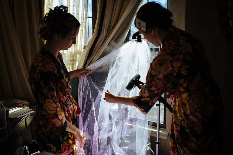 Bridesmaids steaming wedding veil