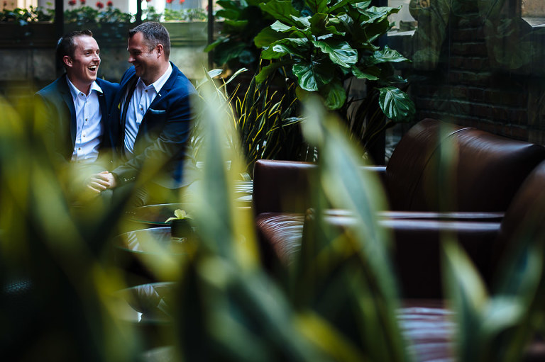 Two grooms at the Library Hotel rooftop