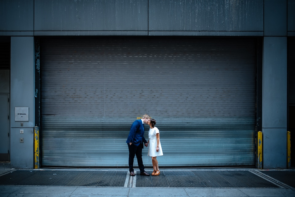 Wedding couple kissing near Times Square