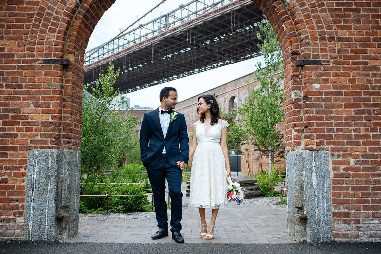 Wedding couple portrait with old brick structure