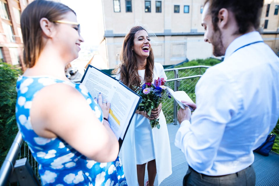 Bride laughing at part of the groom
