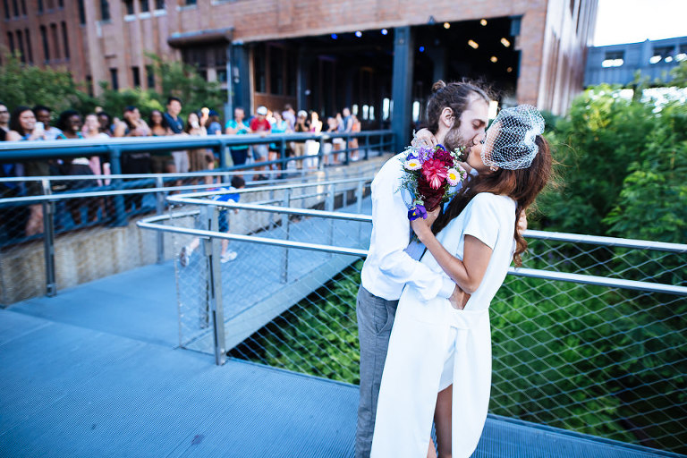 Wedding couple kissing at the High Line at the end of their ceremony