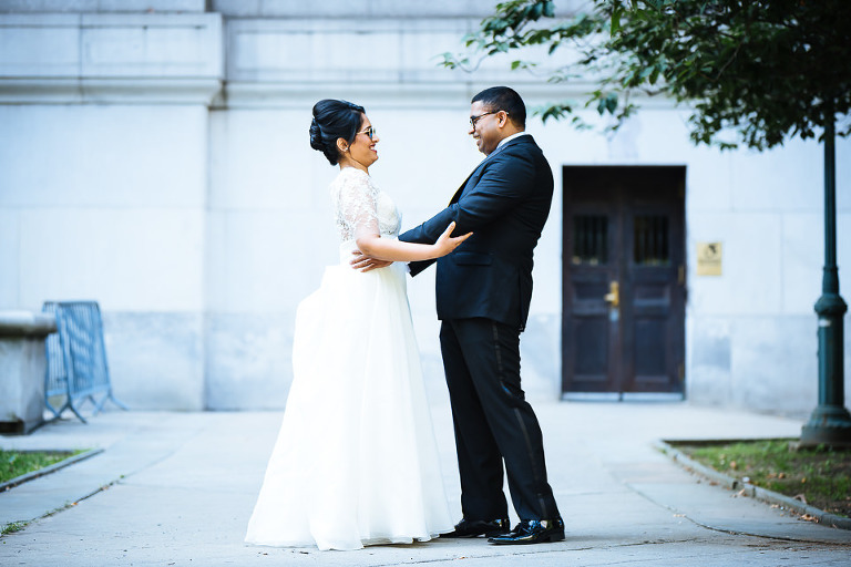 Bride and groom first look outside City Hall
