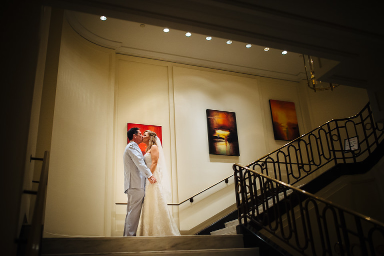 Bride and groom kissing inside the Omni Berkshire Place hotel
