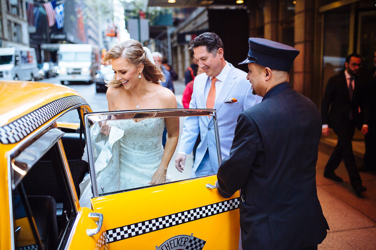 Wedding couple getting into their vintage Checker cab