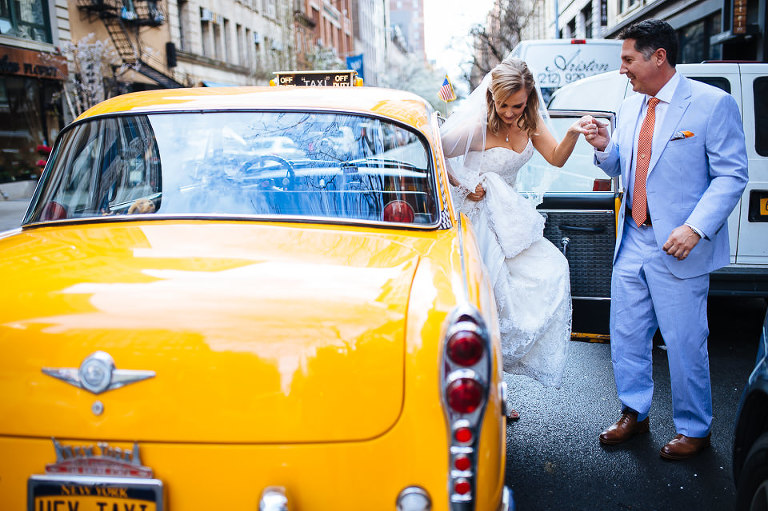 Bride and groom exiting the Checker cab