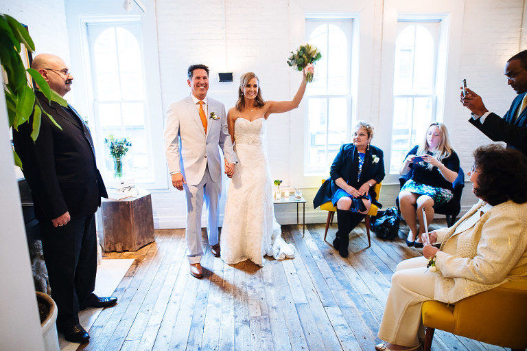 Wedding couple celebrates after their ceremony at Haven's Kitchen