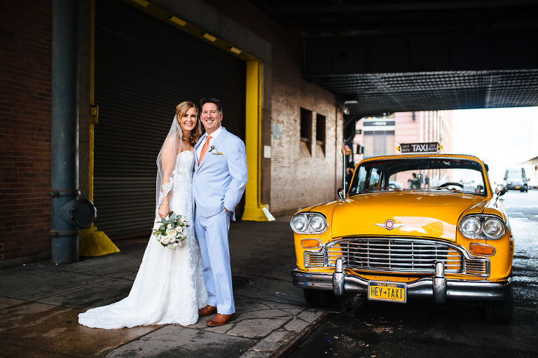 Portrait in Chelsea with bride, groom, and Checker cab
