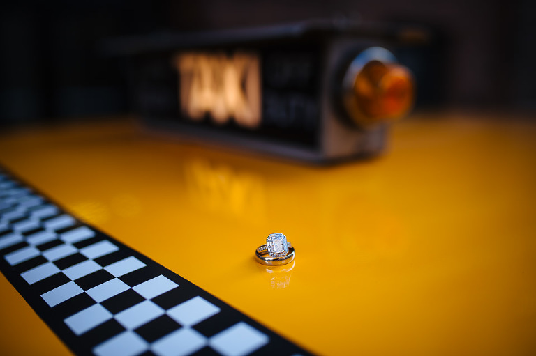 Wedding ring detail photo on top of the Checker cab