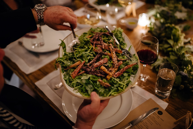 Guest serving family style salad