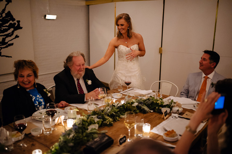 Bride thanking guests for coming to their intimate wedding