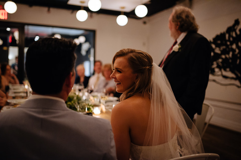Bride laughs during father's speech