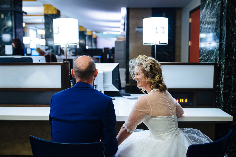 Wedding couple waiting to sign paperwork at City Hall