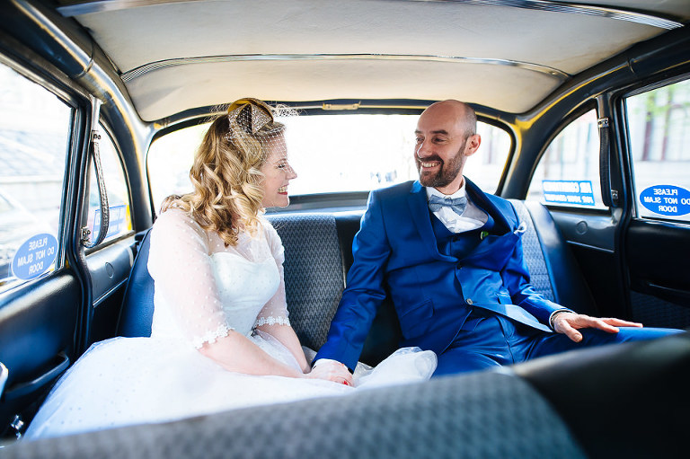 Bride and groom ride Checker cab to Brooklyn