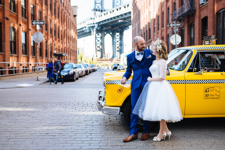 Checker cab and wedding couple in DUMBO, Brooklyn