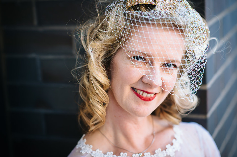 Headshot portrait of bride with birdcage veil