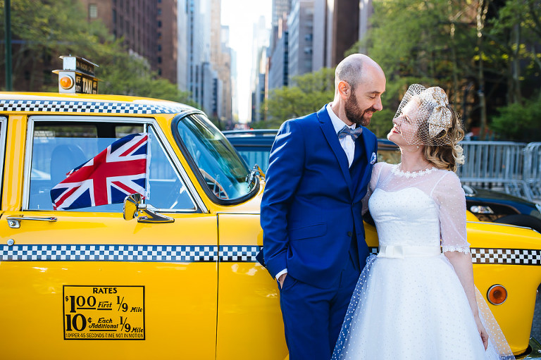 Couple in front of Checker cab in midtown Manhattan