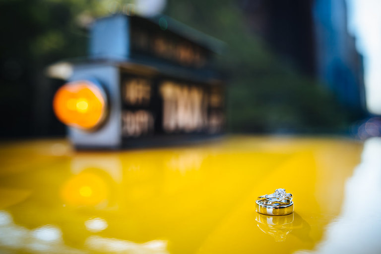 Wedding ring detail photo on Checker cab