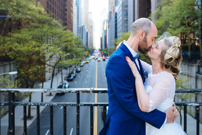 Bride and groom kissing in Tudor City
