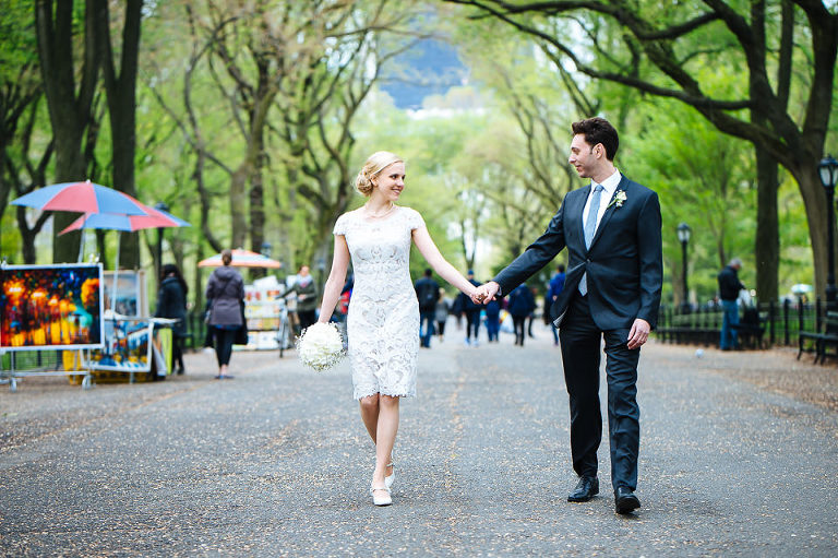 Groom walking the bride down Literary Walk in Central Park