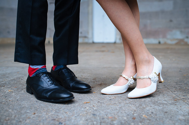 Detail of groom's socks and bride's shoes