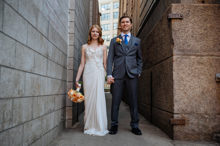 Bride and groom in DUMBO alley