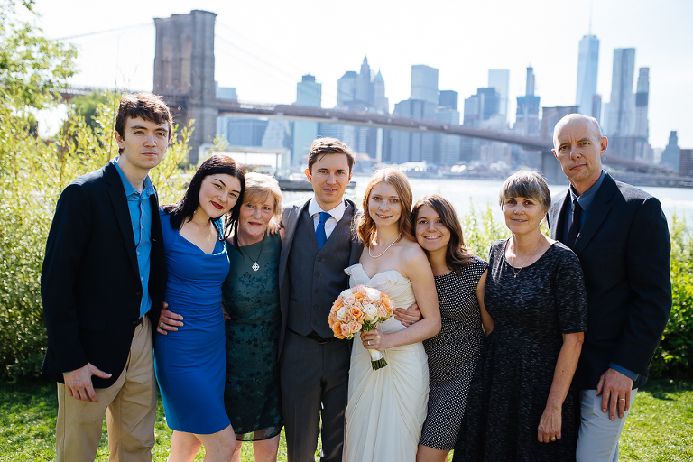 Bride and groom with their wedding guests in Brooklyn Bridge Park