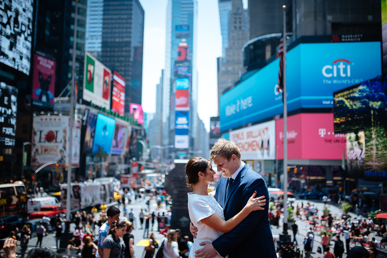 Bride and groom posing in Times Square