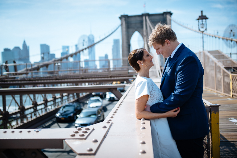 Bride and groom sharing a private moment on Brooklyn Bridge