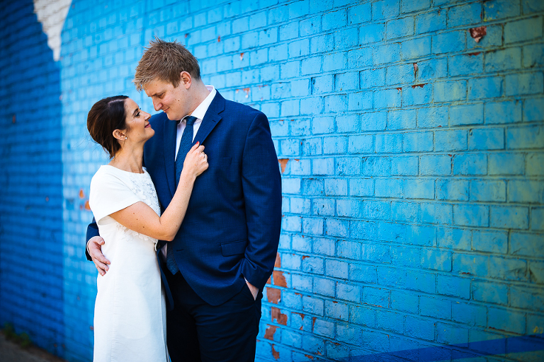 Wedding couple in front of some Brooklyn graffiti in DUMBO