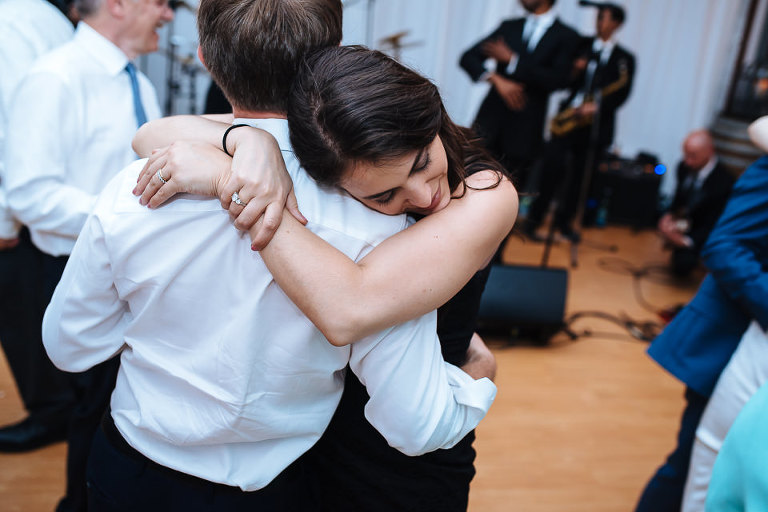 A couple embraces on the dance floor