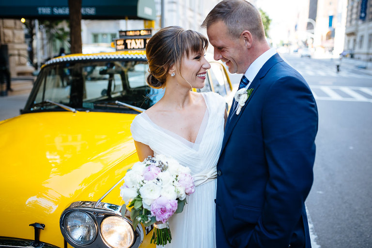 Wedding couple in front of Checker cab