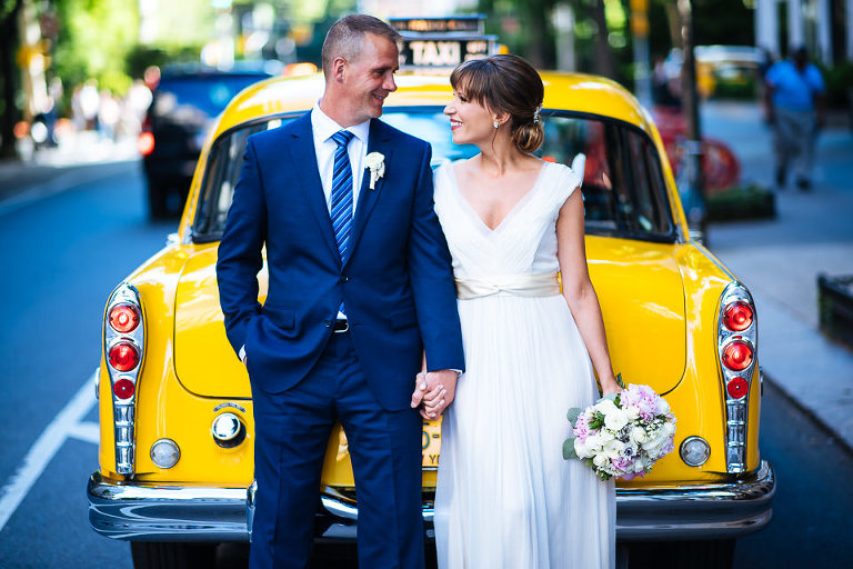 Bride and groom portrait with Checker cab