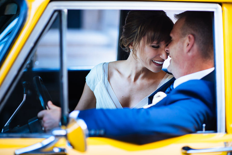 Bride and groom inside Checker cab