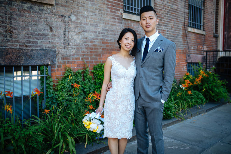 Bride and groom in front of typical Brooklyn architecture