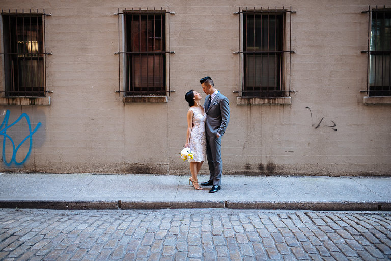 Portrait of wedding couple on Brooklyn side street