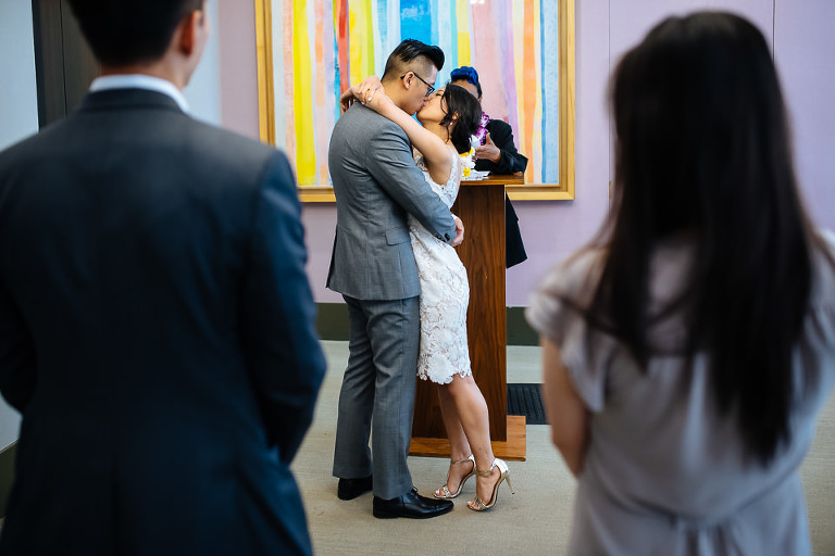 Bride and groom kissing at City Hall ceremony