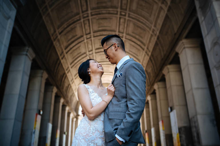 Portrait of wedding couple under downtown Manhattan architecture