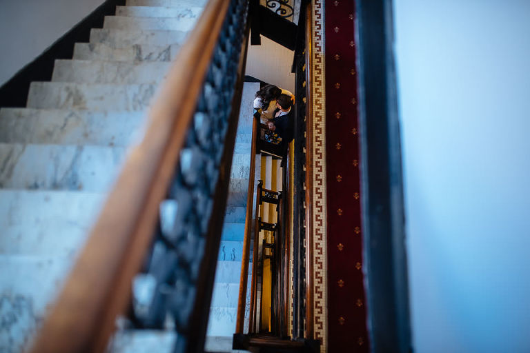 Bride and groom in their UES stairwell