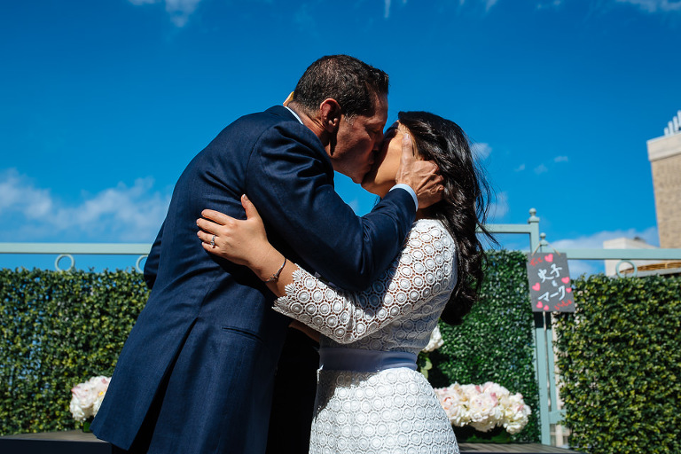 Wedding couple kisses at end of the ceremony