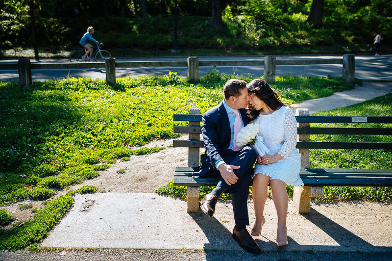 Bride and groom sharing a moment on a Central Park bench