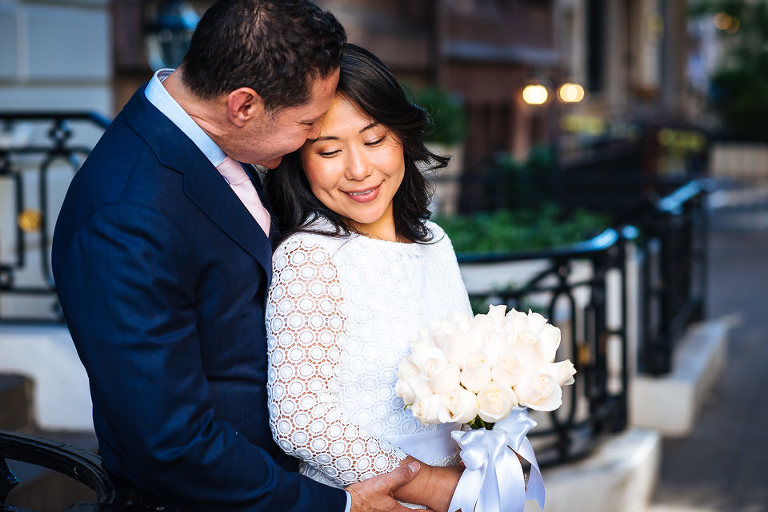 Wedding couple embrace in the UES