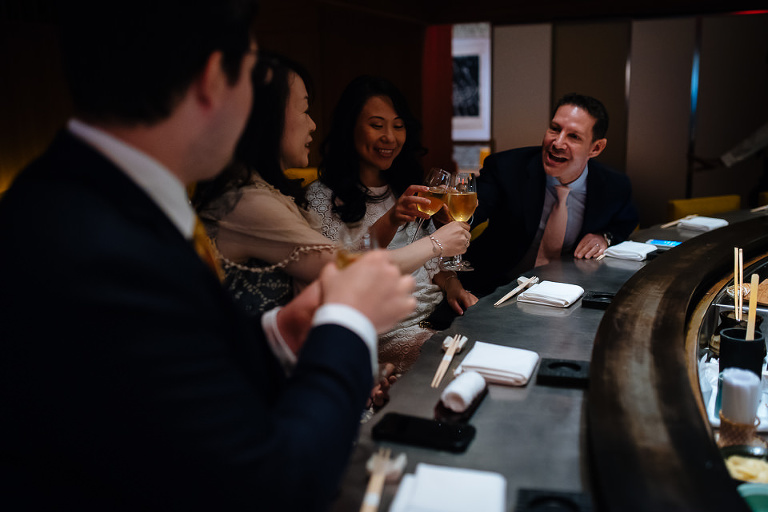 Wedding couple in cheers with guests at Kappo Masa