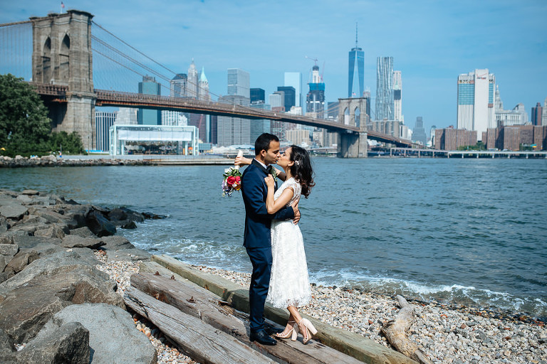 Bride and groom kissing on Brooklyn waterfront