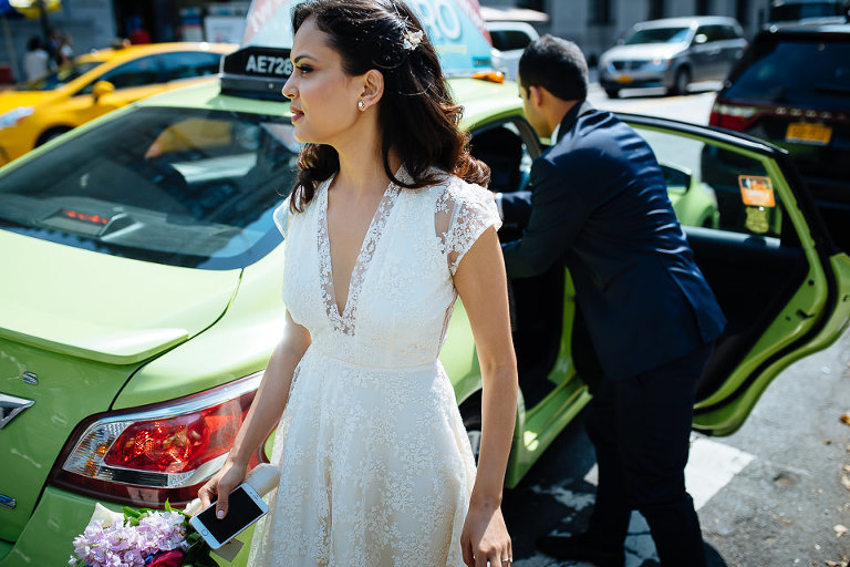 Bride and groom arrive at City Hall in a taxi