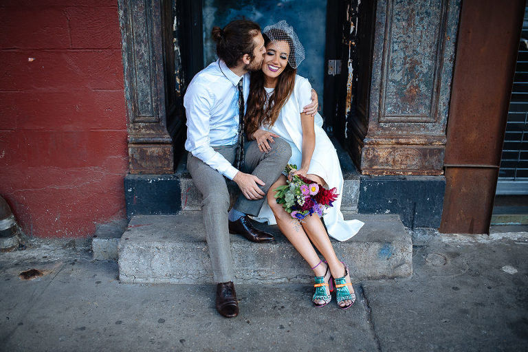 Groom sneaks a kiss in the Meatpacking District