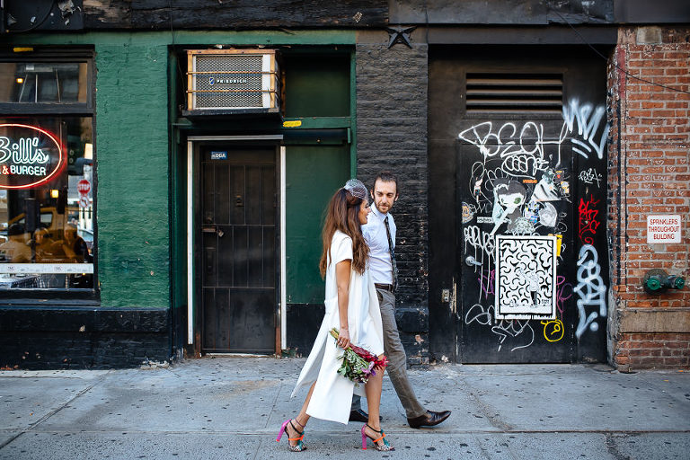 Bride and groom walking past gritty Meatpacking District building